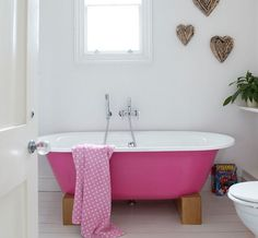 Bright pink tub in the bathroom