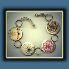 SACRED GEOMETRY Symbols Universal Patterns Altered Art Button Charm Bracelet with Rhinestone. $14.95, via Etsy.
