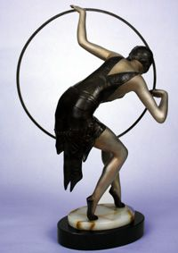 "A striking Art Deco spelter (font d'art) figure by LIMOUSIN, France c1930s, ""Hoop Dancer"", the silver and bronze cold-painted figure mounted on an onyx and black marble base-15.25 in/38.5 cm H. Metal marked Limousin. (hva)"