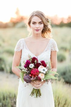 a015099f2e9 This Organic Jewel Tone Wedding Inspiration from Koman Photography features  a burgundy bouquet and a gold bar cart.