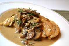 Chicken Fillet Stuffed with Cheese, Mushroom Sauce  - sounds good but would use different kind of cheese to stuff it