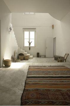 White interior & Kilim Rug