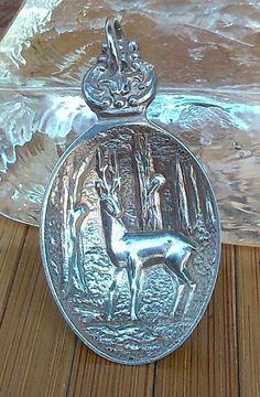 the deer in the woods pendant I made from a collector spoon