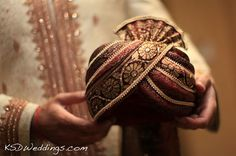 Groom's gold and maroon turban