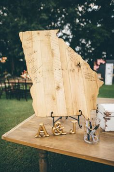 Why sign a guestbook when you can sign this cute Nebraska-shaped wooden plank instead?  | Image by  Amber Phinisee