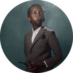 """Kids all dressed up in vogue garments, all having smoking """"stuff"""" and wearing grown-up, solid faces are the subject of the series """"Smoking Kids"""" of the Belgian photographer Frieke Janssens."""