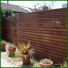 Nice fence with horizontal rails. http://www.jjslandscaping.com/images/seattle-wa-fence-installation.jpg