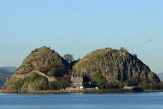 "Dumbarton Castle, taken from the south bank of the river Clyde. ""Dun Breatann"" or fortress of the Britons, has a recorded history as a stronghold which is longer than any other fortification in Britain. The earliest reference is to St Patrick who wrote about it in 450AD."