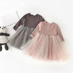 Pretty princess dress with layered tutu skirt and little gold stars that sparkle when they catch the light. Made from a cotton blend material, available in pink or gray/brown colorways.