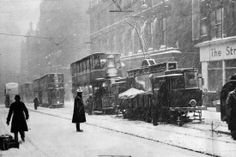 A blizzard on a Glasgow street brings trams and buses to a grinding halt in 1947