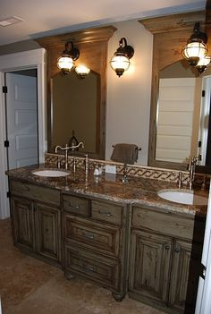 love how this vanity looks like a built in cabinet.  Beautiful.