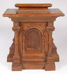 Antique American carved mahogany podium with adjustable top and column form base circa 1910.