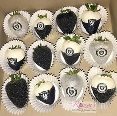 Glamorous candy covered strawberries with a Raiders theme.