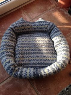 DIY dog bed made from an old sweater