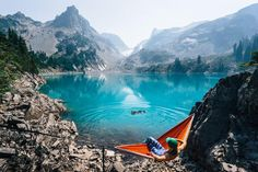 Relaxing after a long hike while the pup enjoys a little swim. The incredible color of this lake took our breath away! Apline Lake, Washington.