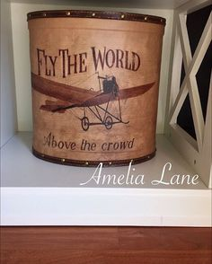 How amazing is this leather wrapped oval storage bin!!?? I got it @homegoods for $14.99 I don't know what I love more!? The leather, the distress, the shape, the picture of the vintage airplane, or the quote! Everything combined just makes it a stunning piece! #amelialane_ #designonadime #design #designideas #decor #decorating #decoratingtricks #decoratingtips #decoratingfinds #budgetfriendly #home #homeaccents #homedecor #homedesign #homestyle #homesweethome #cheapchic #countrychic…