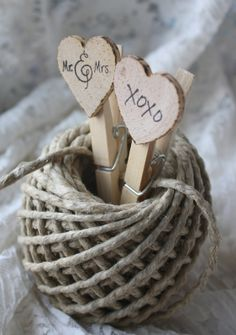 Clothespins are not only useful household items but are adorable used in wedding decor. They are used in many types of weddings: from rustic, shabby chic and vintage to outdoor and even botanical themed weddings.   These handstamped, woodburned heart clothespins add that simple elegant homespun...
