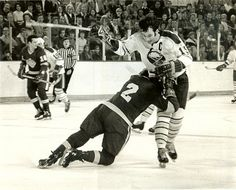 1971-72 Sabres-Kings action shot. Sabres' Gerry Meehan being blocked by LA Kings' Bob Woytowich.