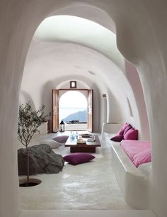 Incredible doors and view, love the tree and the natural simplicity of this room