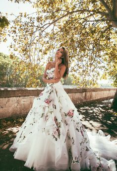 Don't limit yourself to traditional white, the romantic touch from this Alessandro Angelozzi  Couture 2015 gown adds a feminine touch of floral to a wedding gown.