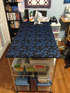 I've been busy spring cleaning. One of my projects was to replace the fabric on my ironing board table. I made this ironing board table when...