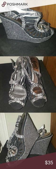 Zebra bling wedges Black/silver zebra strappy wedge! Worn once indoors.  Bought at the Buckle. Daytrip Shoes Wedges