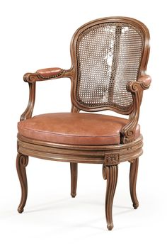 A carved and molded beech armchair, late Louis XV, attributed to Georges Jacob