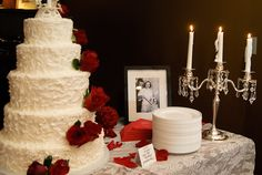 Vintage wedding pics of Bride and Groom's parents decorate the cake table #debmemories