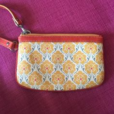 Precious ORANGE print wristlet. ORANGE floral print wristlet with blue floral print inside. Pockets for cards and a zippered pocket inside. Never used. Bags Clutches & Wristlets