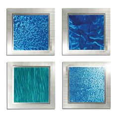 Set of Four Oceanic Wall Art  Ties together the various colors of blue through the room.