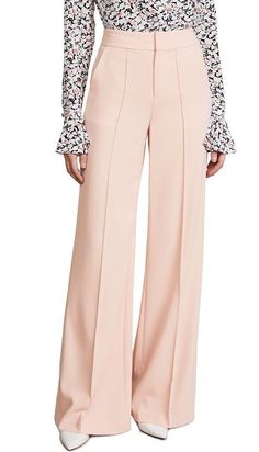 dylan high waisted leg pants by Alice + Olivia. Effortless alice + olivia trousers with a fluid, floor-skimming silhouette. They're the ideal style when you want to add a little '70s cool into a workday look. Fabric: Crepe suiting Seamed creases Trouser styling Wide-leg cut Hook-and-e... #aliceolivia #pants