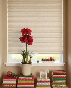 Simply cover books with Christmas gift wrap to add a bit of holiday spirit and style with Vignette® Modern Roman Shades. ♦ Hunter Douglas window treatments #HolidayDecor
