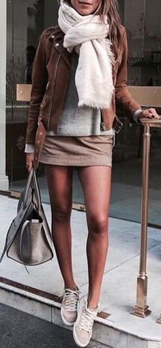 A tan leather jacket, corduroy skirt, sneakers and scarf make for a perfect fall outfit!