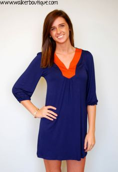 Victory Dress for Auburn! This dress is a comfortable cotton fabric, and will have you comfortable for game day! The model is 5'6 and is wearing a small (material does contain spandex). The colors are navy and orange.