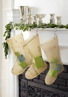 sewing pattern stockings with tape measures!  27 Inspiring Christmas Fireplace Mantel Decoration Ideas | DigsDigs