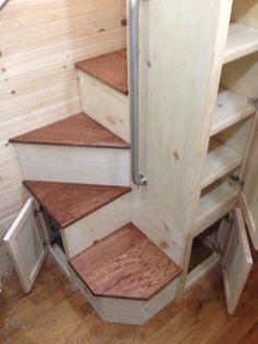 """Spiral"" stairs with storage to disguise it..."