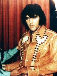 """Elvis Presley in the iconic """"wine"""" leather suit (Elvis wore it once and retired it after this show)."""