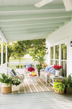 Colorful Texas Porch | Patios and porches are an integral part of Southern culture. These classics are inviting and inspiring. It's no secret that we Southerners live for our porches. Is there any memory sweeter than those of childhood suppers on screened porches, or swinging the night away on the perfectly-designed porch. Face it: we pay for our mild winters with our sultry summers, and while modern air-conditioning may have made those deep porches of the past unnecessary, our Southern…