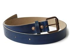 Our Men's Leather Belt is a full-grain handmade piece hand-dyed in our custom Yves Klein Blue Hue. Made of pure veg-tan leather, it's a durable lifetime belt.