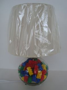 Glass lamp filled Lego style toy building blocks - includes lamp shade, adorable Nursery lamp for boy or toddler bedroom. $39.99, via Etsy.