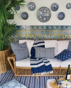 Moroccan ceramic plates hung above original-to-the-home tiles enliven this loggia.