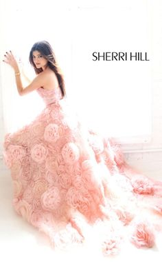 Sherri Hill, Kylie Jenner, Kendall Jenner    I remember seeing this dress when i was in 11th grade looking for a prom dress online and thinking that some day it would be my wedding gown. is a pink gown too cheesy though?