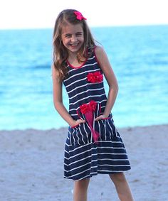 Add  fresh color to a sweetie's wardrobe with this delightful dress. Featuring bead-embellished flowers, a contrast trim and a handy kangaroo pocket, it'll put a spring in their step and a smile on their face.