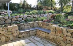 Wall consisting of Weser sandstone and a elaborate seating area. - Wall consisting of Weser sandstone and a elaborate seating area. Love Garden, Shade Garden, Back Gardens, Outdoor Gardens, Sandstone Wall, Pergola Shade, Diy Pergola, Pergola Kits, Garden Features