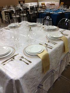 Gold Beaded chargers, White nova swirl linen, Gold nova napkins, Pure glassware, and Falmouth flatware.