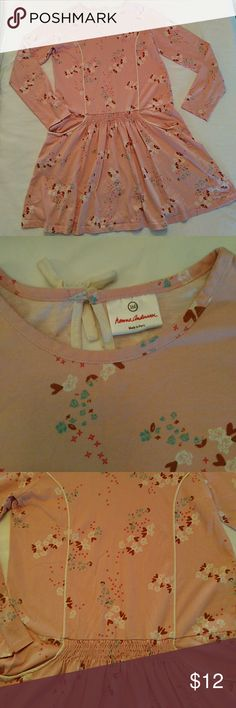 Hanna Andersson Girls Long Sleeve Dress 160 Cute pink with flowers and hearts print long sleeve dress by Hanna Andersson. Dropped waist, pockets. Keyhole opening w bow on back. Knit cotton. Sz 160 or 14 US. Light wash wear, no tears, spot on back of one sleeve (last pic) Hanna Andersson Dresses Casual