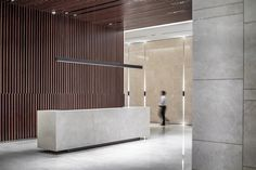 Reception counter at China Square Central, Singapore by DP Design