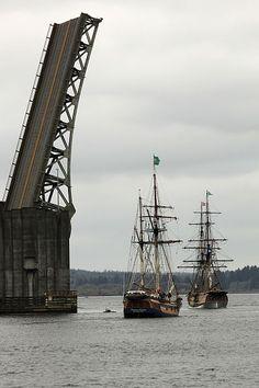 Hawaiian Chieftain, left, with Lady Washington, pass near a bridge. http://historicalseaport.org #sailing #ships #travel