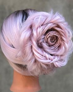This Connecticut-based stylist's braided rose updos create a whole new meaning for 'Stop and smell the flowers.'