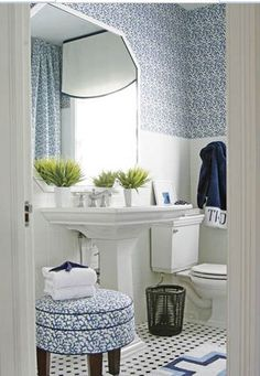 T. Keller Donovan did a great blue and white bathroom using Clarence House's Outdoor Coral in Marine. The outdoor fabric in the bathroom will make it last longer with the moisture resistant properties.